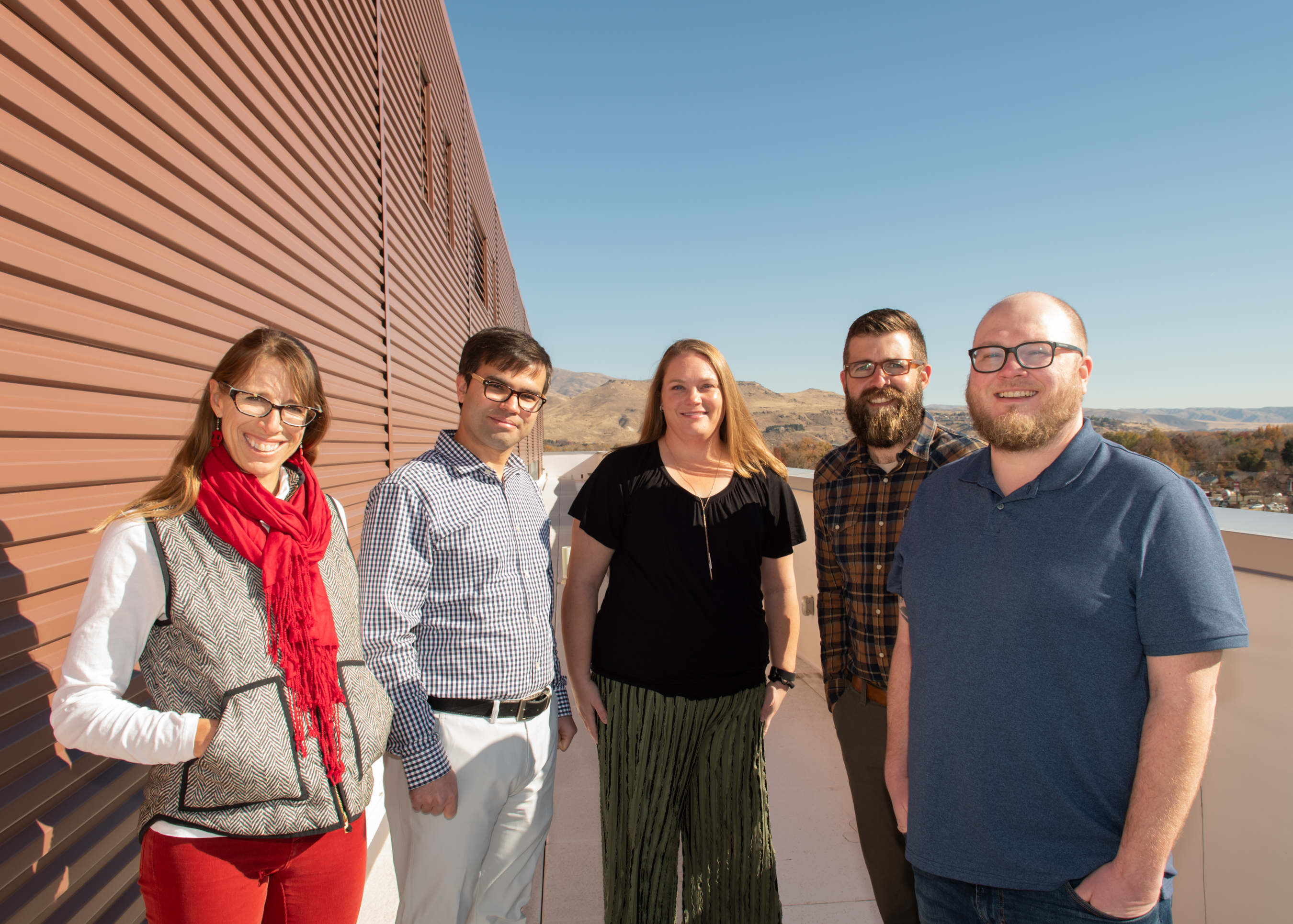 Group photo of interdisciplinary team on rooftop