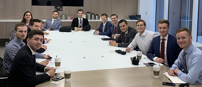 boise state students at a large conference table in new york city