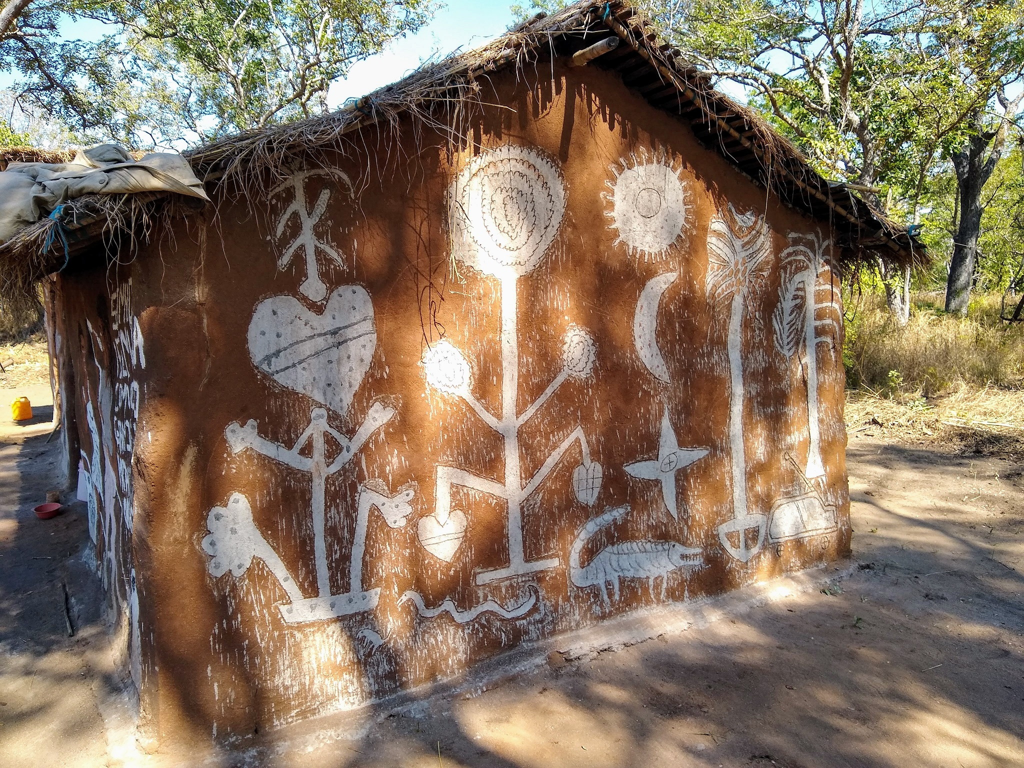 Fertility and protective symbols are painted on side of house in Mozambique