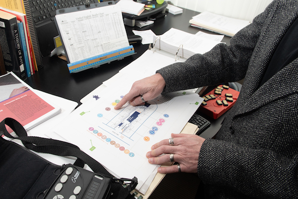 Don Winiecki in his office with maps of the Main Street Station.