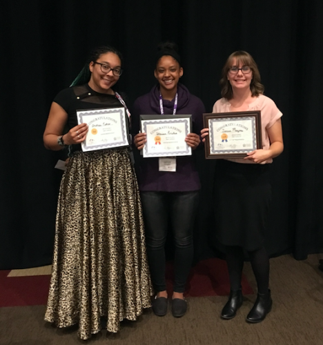 Three students show off their awards