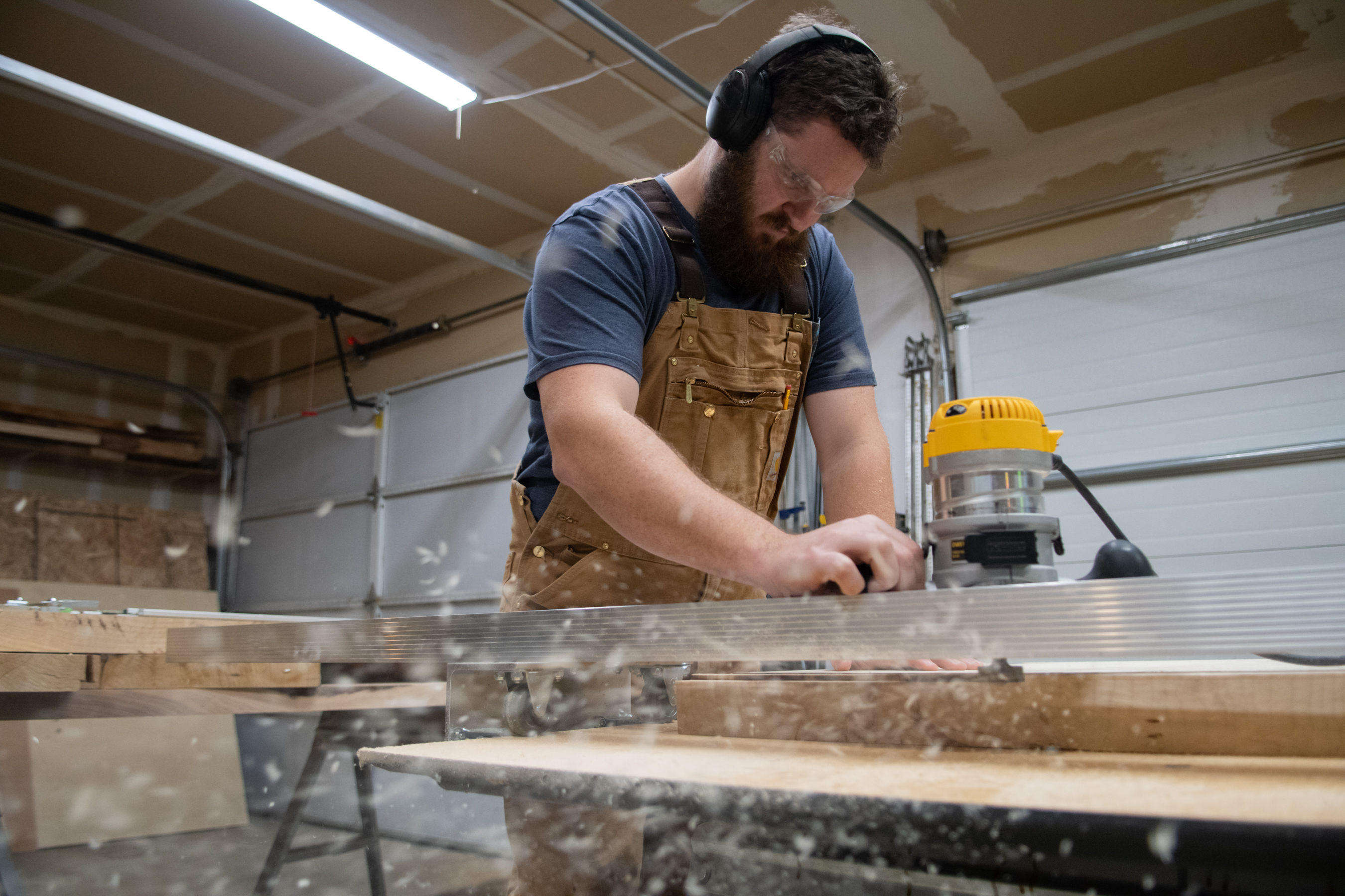 Alex sanding wood in his shop