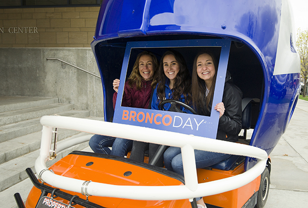 Photo of Boise State students and friends in the Helmet Car at Bronco Day 2017.