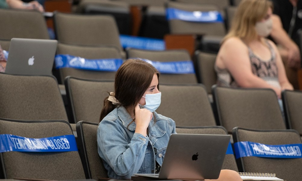 Student in socially distant lecture hall