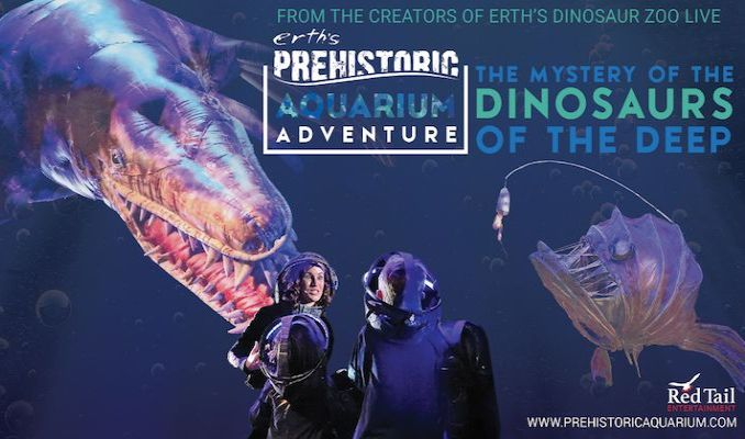 Photo of performer from Erth's prehistoric aquarium adventure in front of photo of aquatic creatures