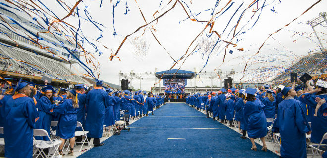 Spring commencement ceremony on the blue turf