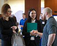 students talking with employer at career fair