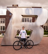 Cole Cunningham poses in front of Boise State B with his bike