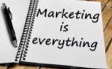 Notepad with Marketing is Everything written on it.