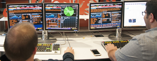 student in MBEB Dykman Trading Room