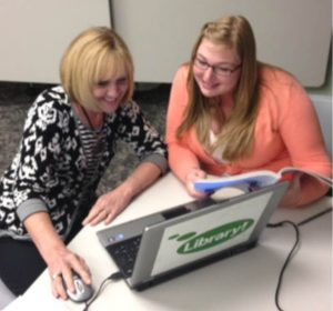 student helping client file tax returns