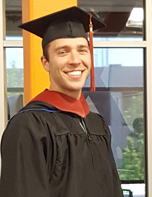 Christian in graduation cap and gown