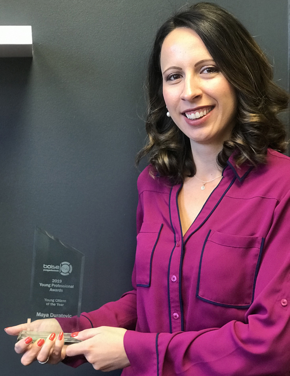 Maya Duratovic holding her Young Professianal of the Year award