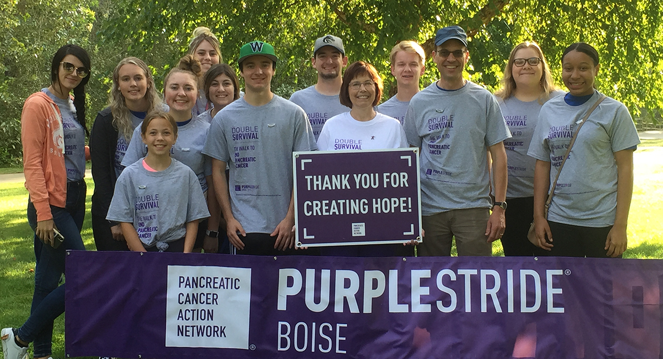 students with purplestride banner