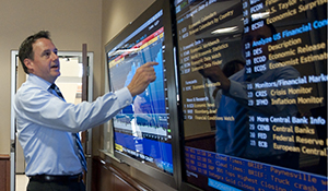 Keith Harvey in Financial Trading Room using Bloomberg touchscreen