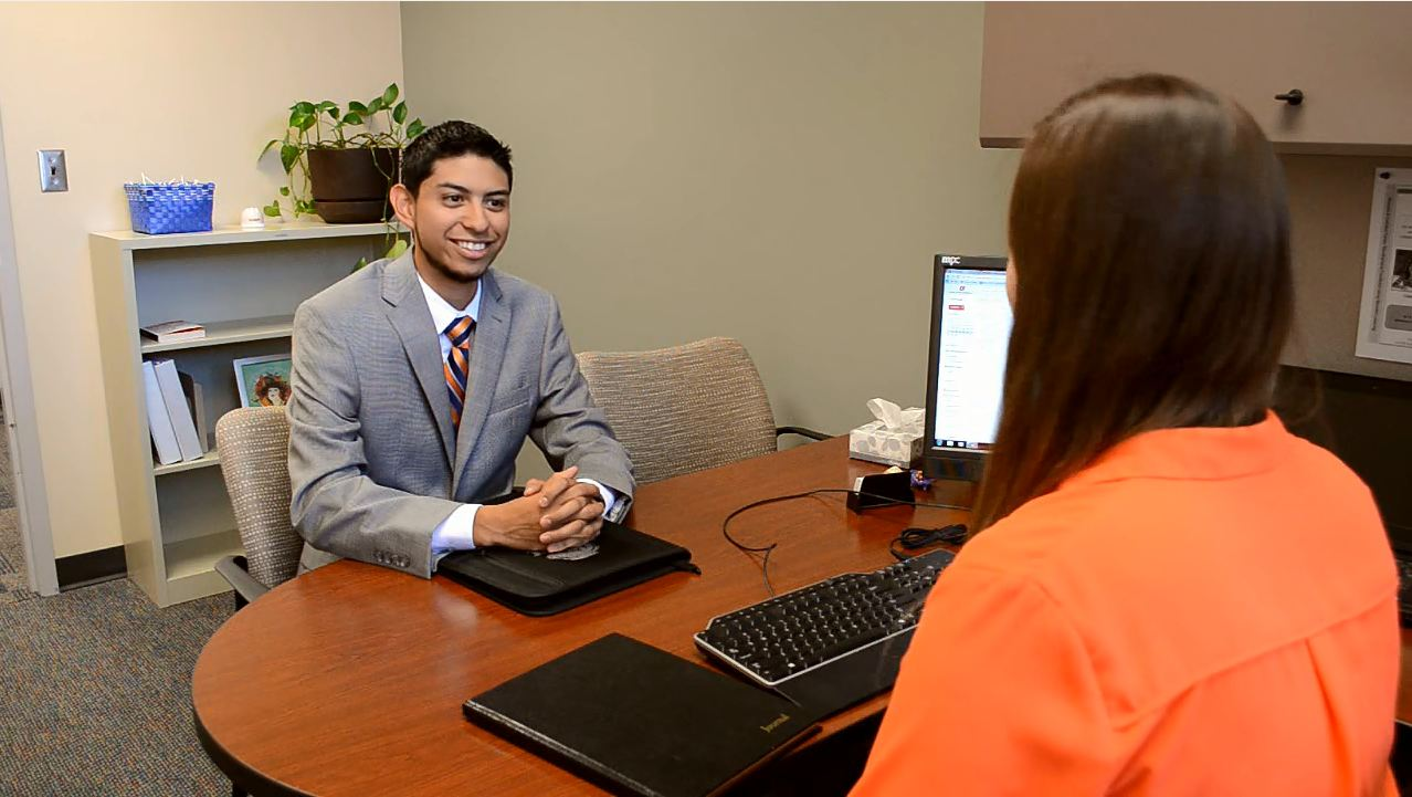 Student interviewing in an office