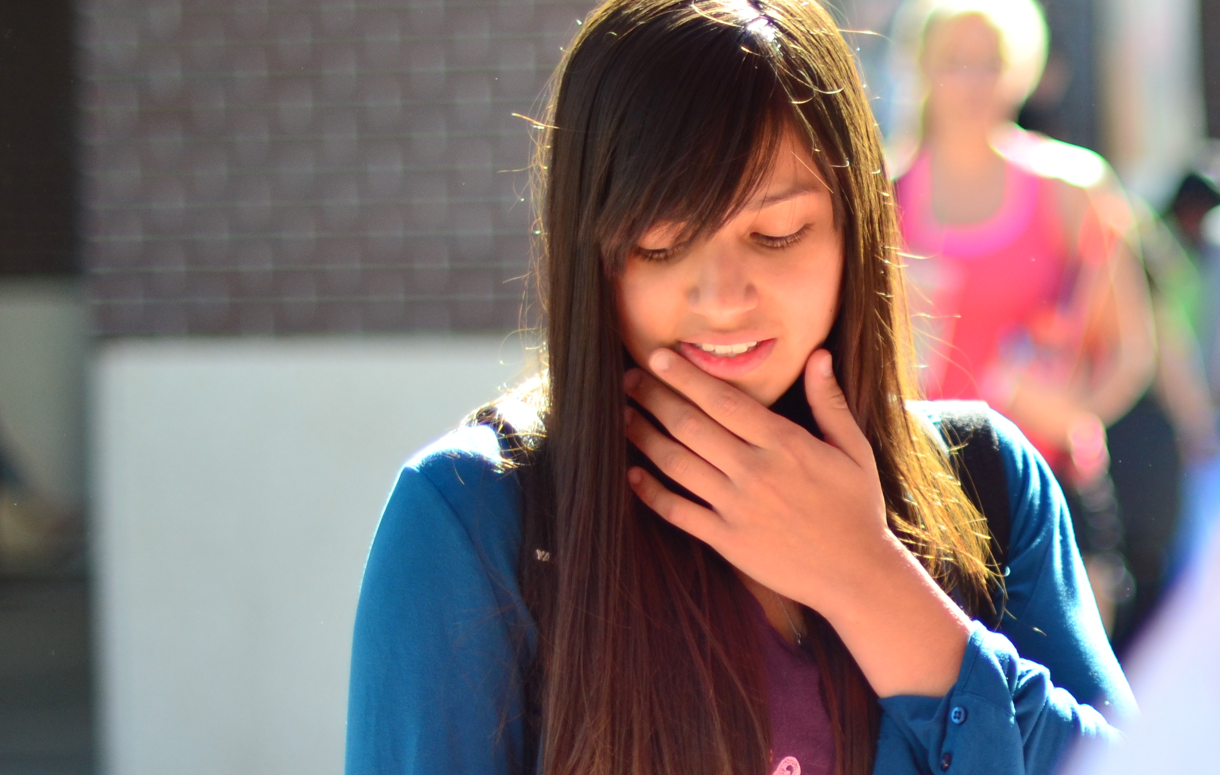 Student with hand on face contemplating something