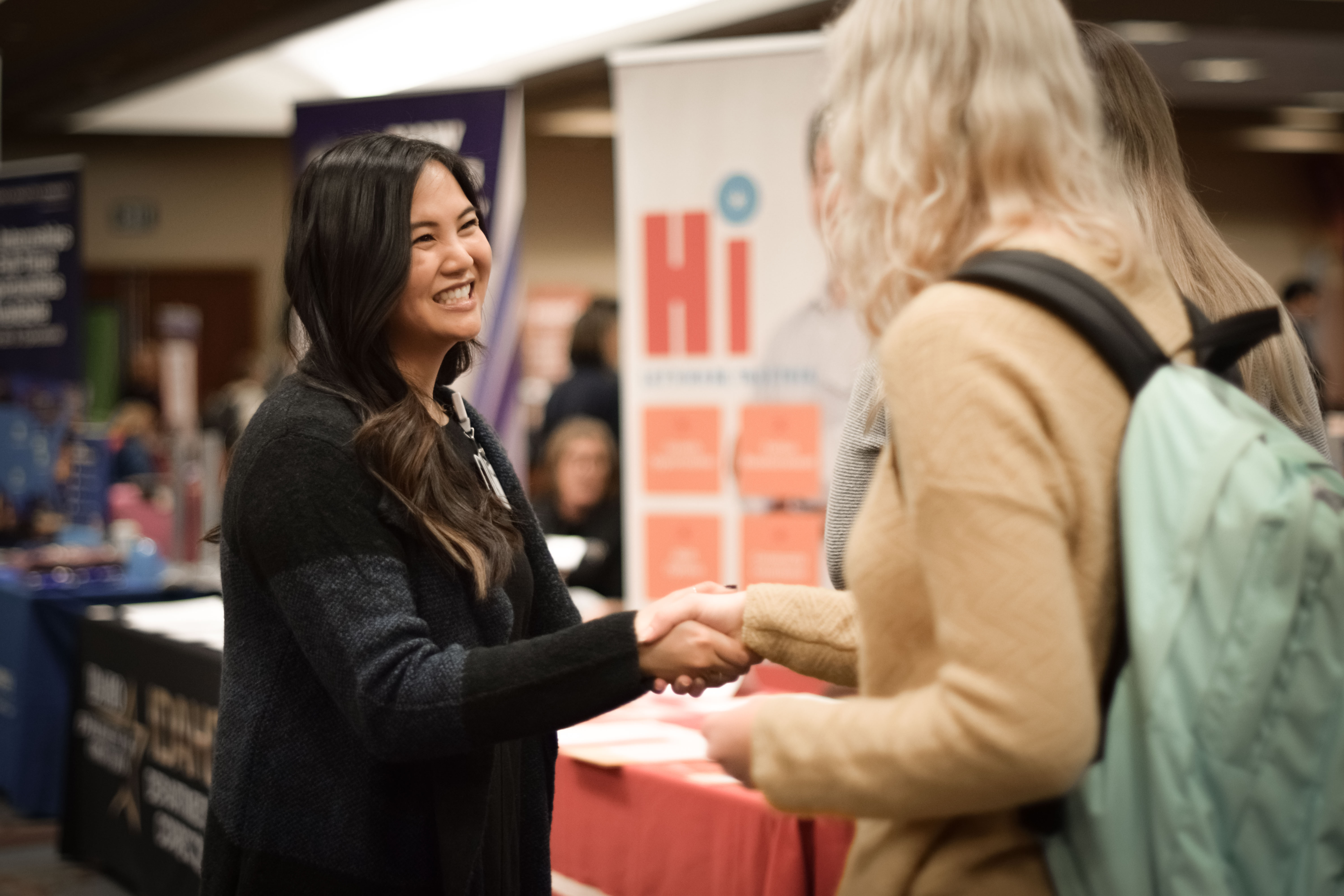 Student shaking hands with employer