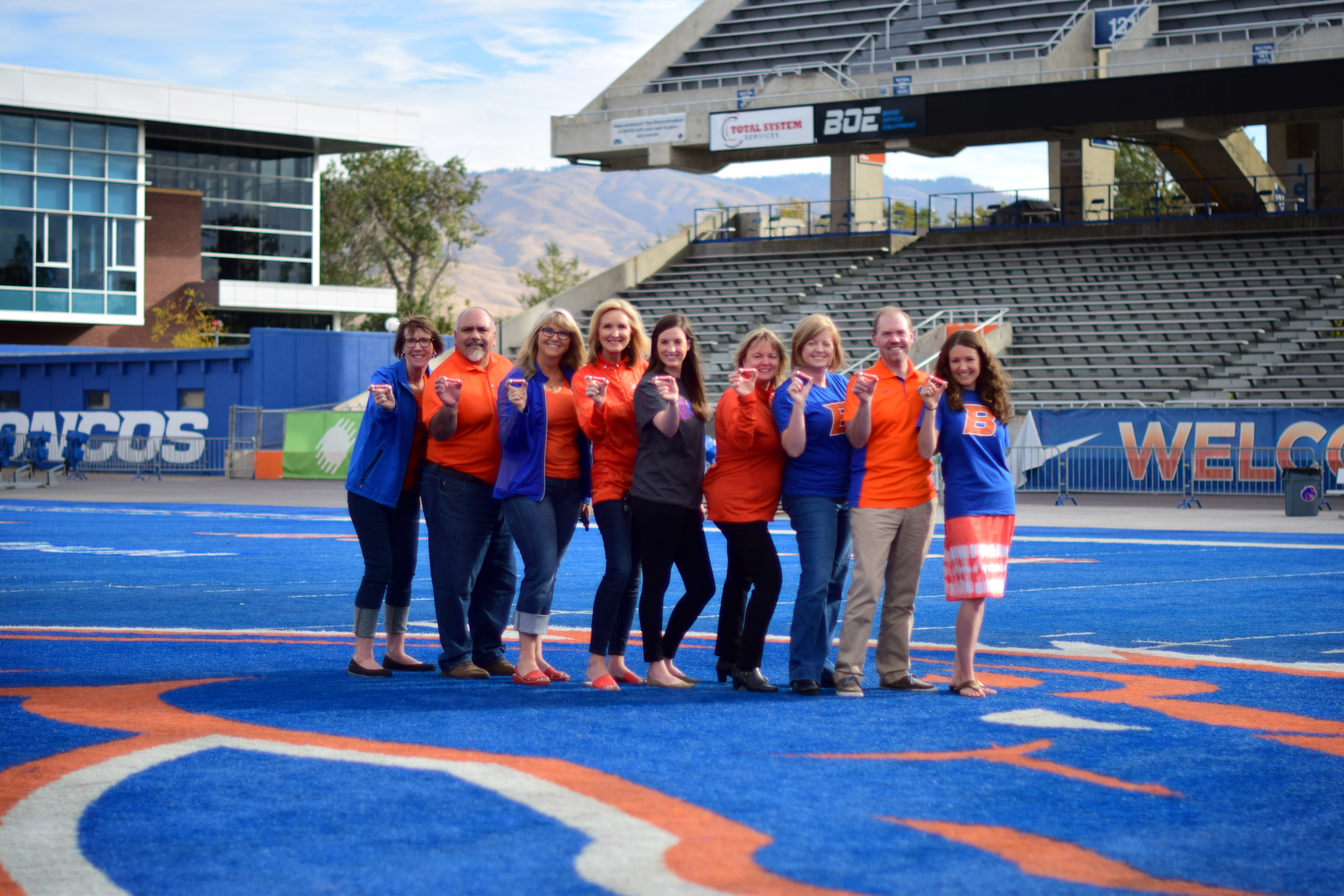 Some of the Career Center staff posing on the blue turf