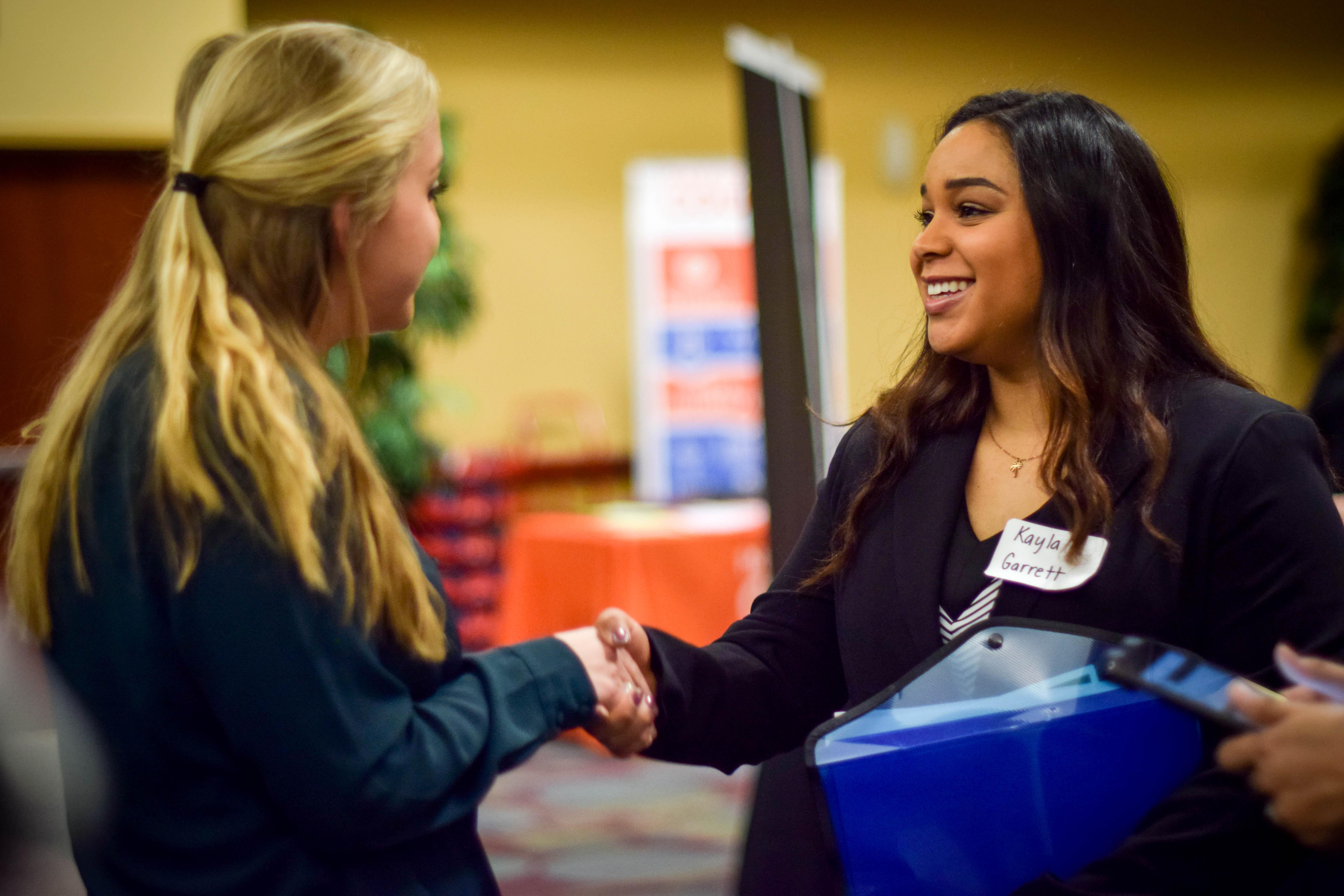 Student shaking hands with an employer at the Career Fair