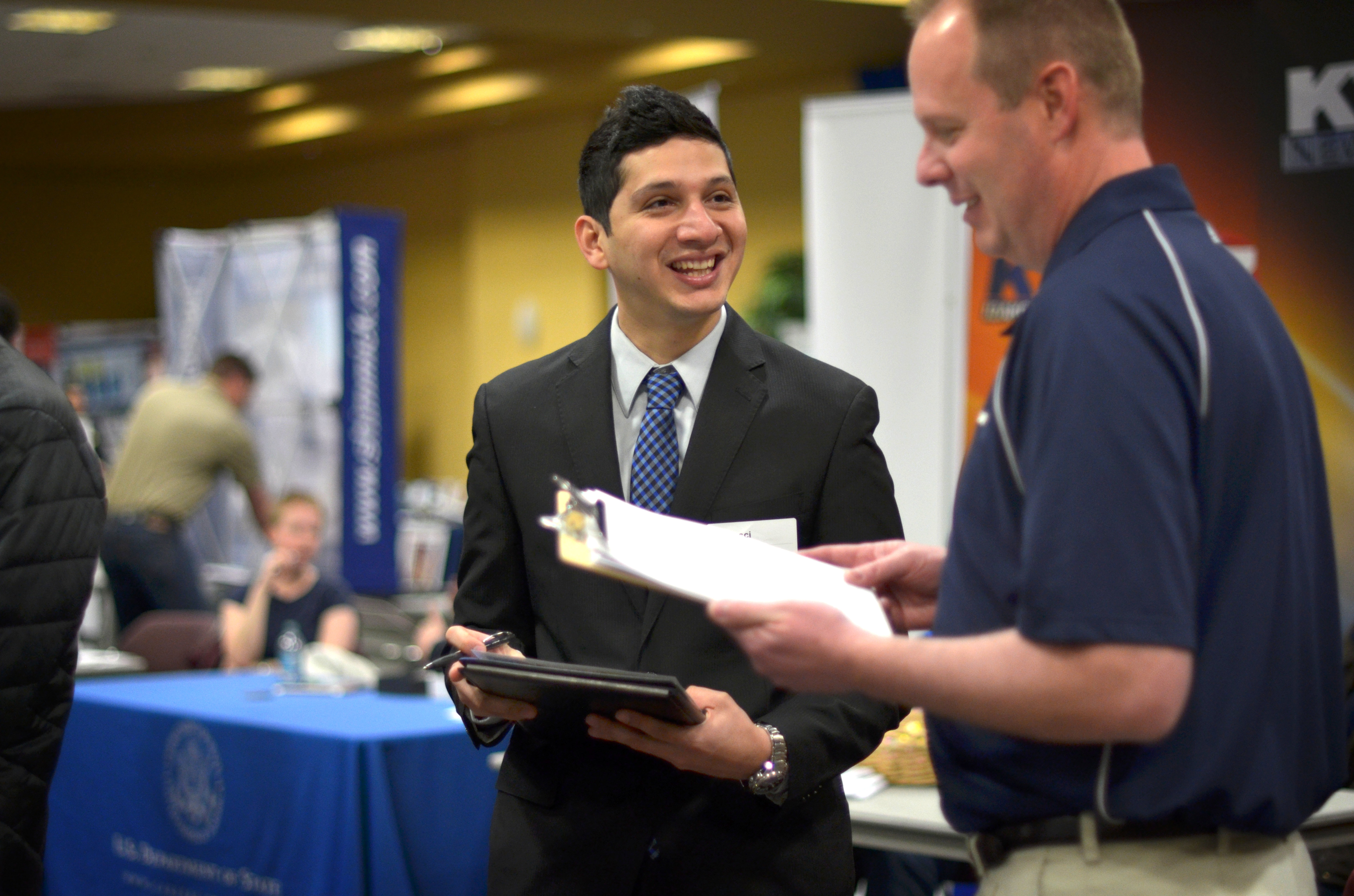 Student networking with an employer at the Career Fair