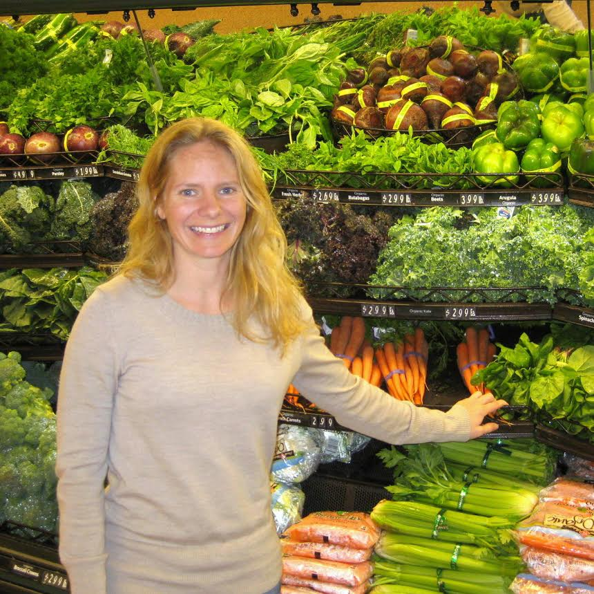 Cynthia standing in a produce aisle
