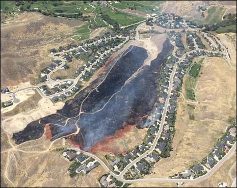 View from sky of wildfire damage in foothills