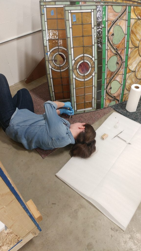 Boise State student Aimee Rollins restores stained glass as part of Idaho State Historical Society internship