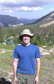 Kevin Feris outdoors with mountains
