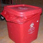 improperly secured waste container with the bag drooping outside the can