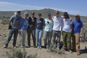 Group photo of Jen Forbey and her research group in the field