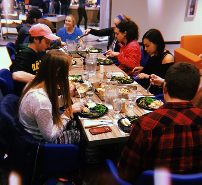 students enjoying dinner at Bronco Family Table in South Fork Market