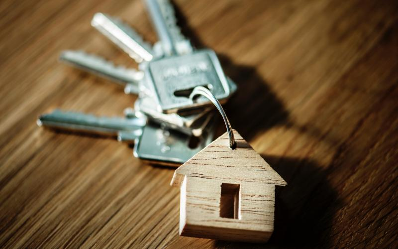 Keys and a wooden house on a keychain