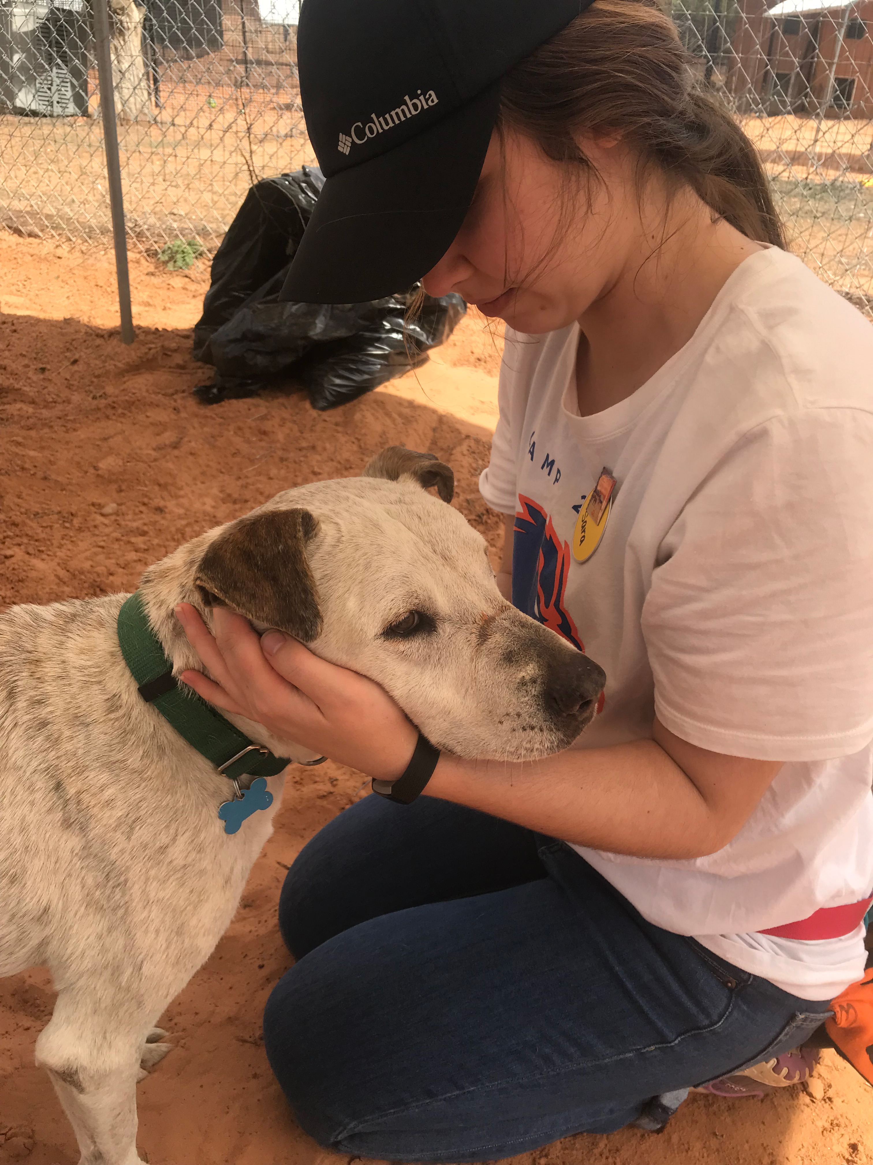 student petting dog at best friends animal sanctuary