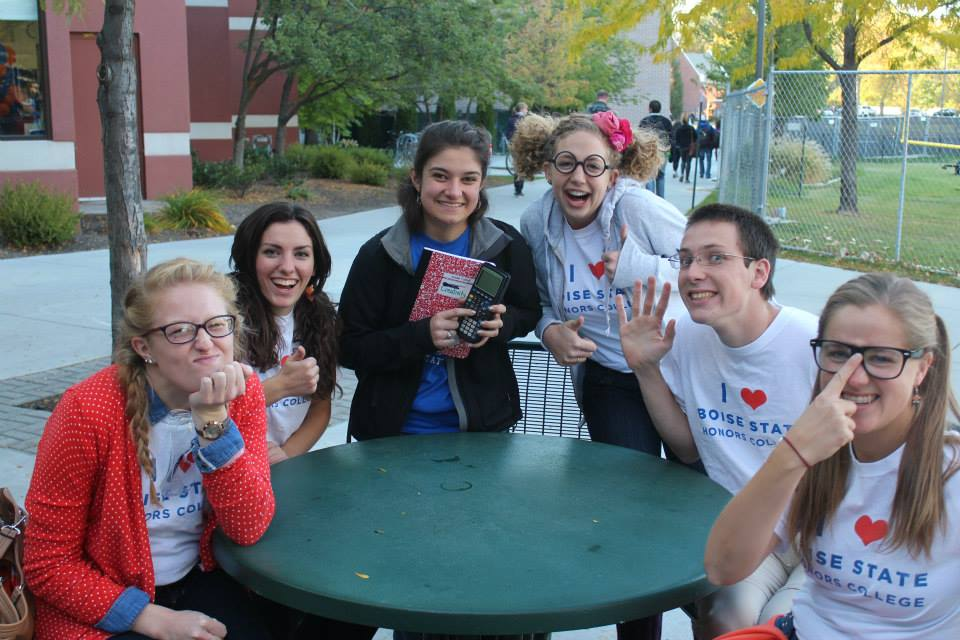 Group of students posing with nerdy faces with T-shirts that read 'I (heart) Boise State Honors College