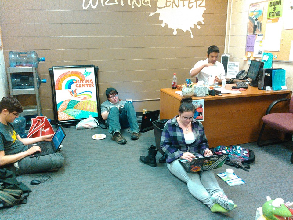 students lounging and working in the writing center