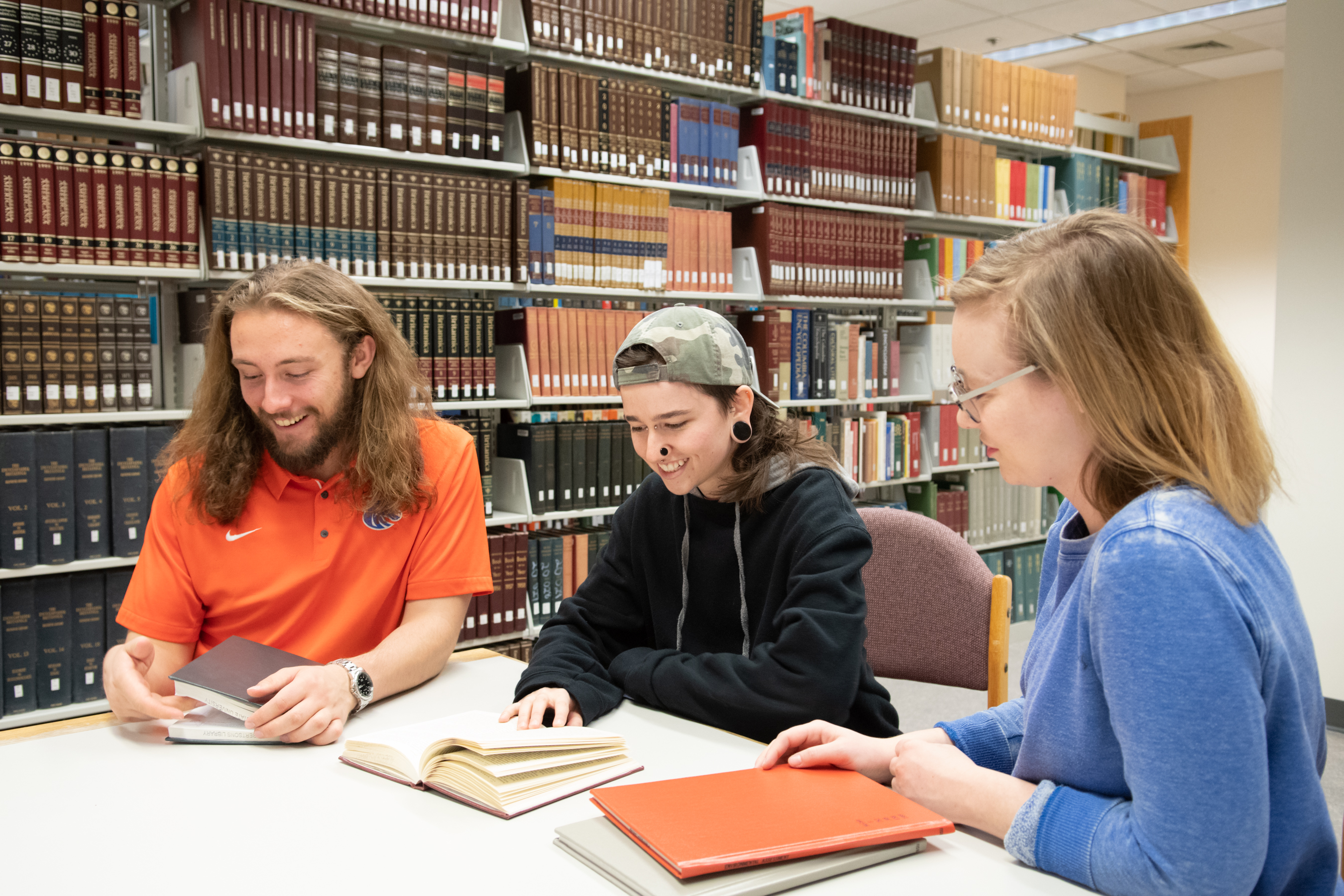 Three students studying together in the library