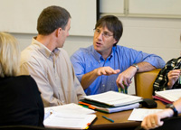 Coworkers talking at conference table