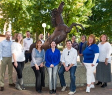 photo of professional staff members near the bronze bronco statue