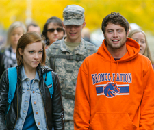photo of students walking through the campus quad