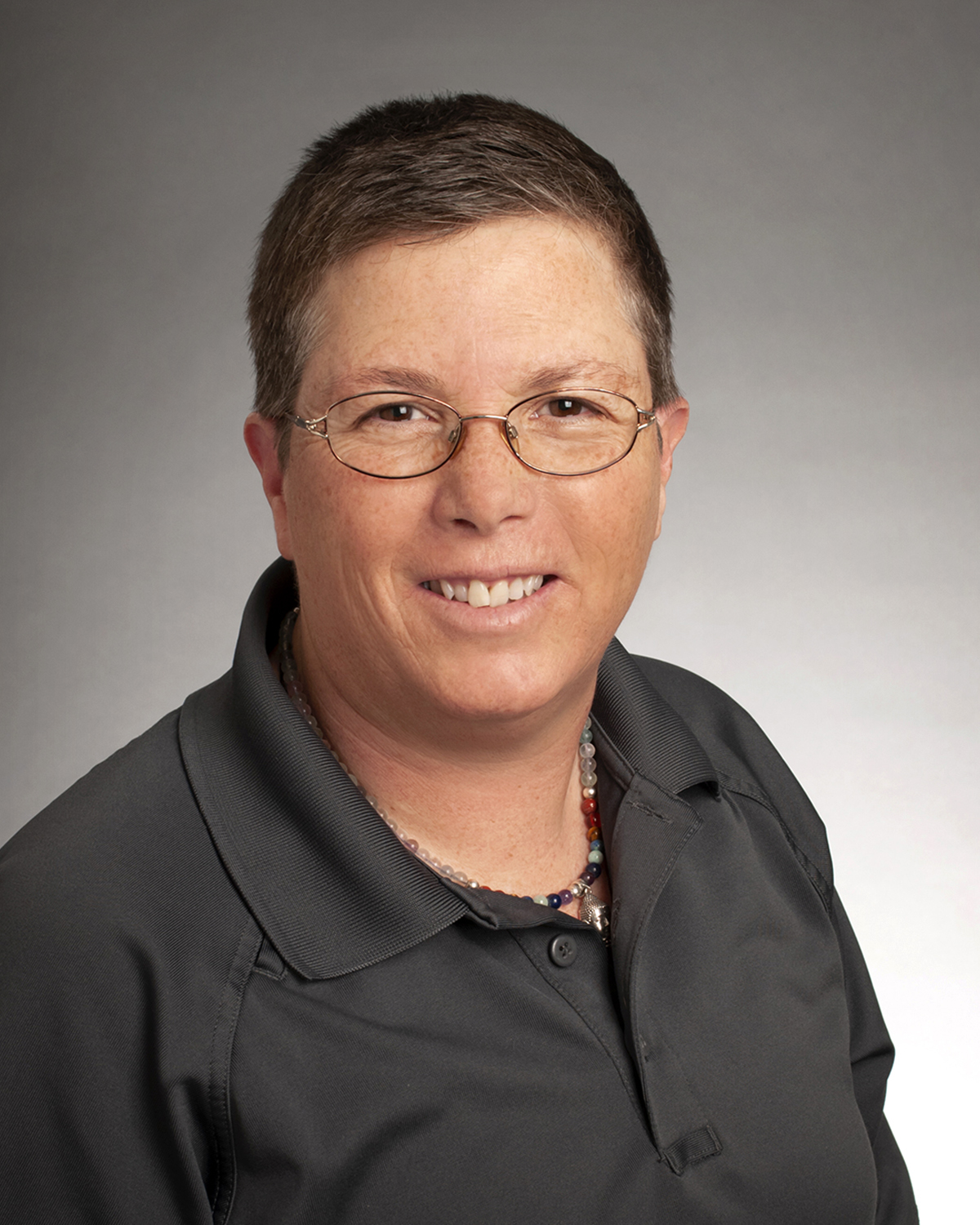 Kim Gibbons, Public Safety, faculty/staff, studio portrait by Priscilla Grover