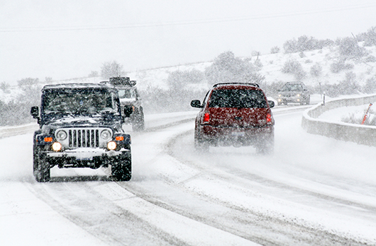 Pictures of automobiles driving winter weather conditions