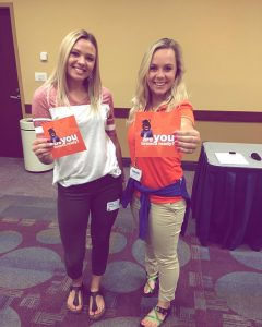 Students at orientation holding Bronco Ready flyers