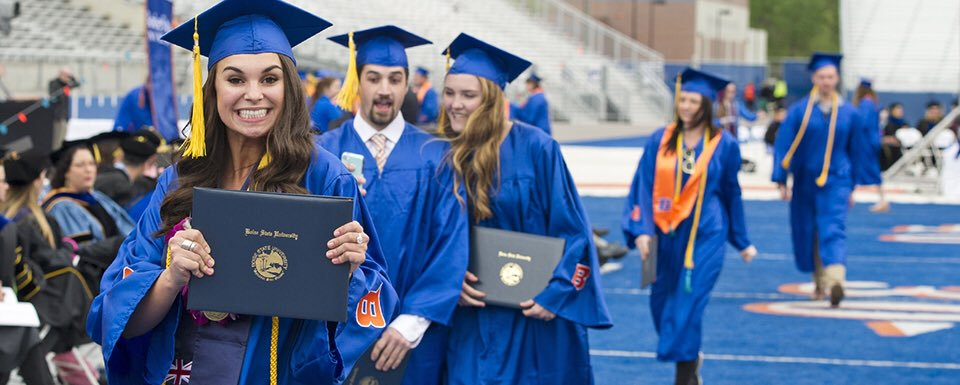 Spring commencement on blue turf