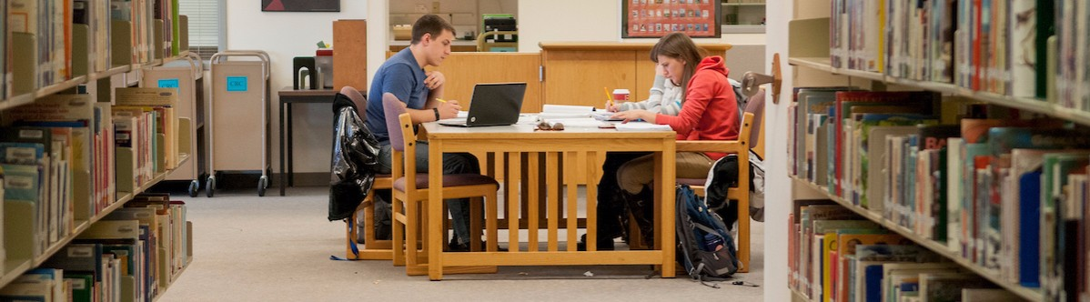 Boise State students studying in Albertson's Library.