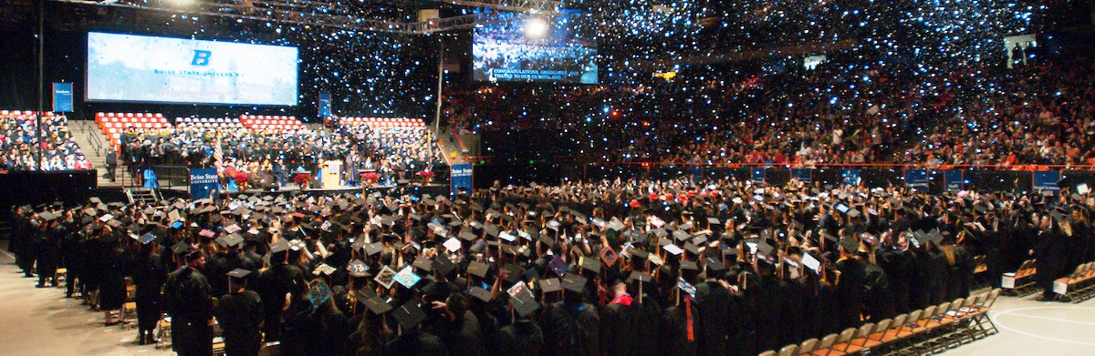 A wide shot of a commencement ceremony.