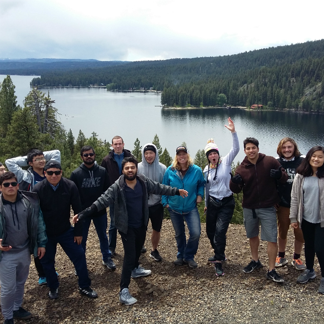 Photo of students by a lake