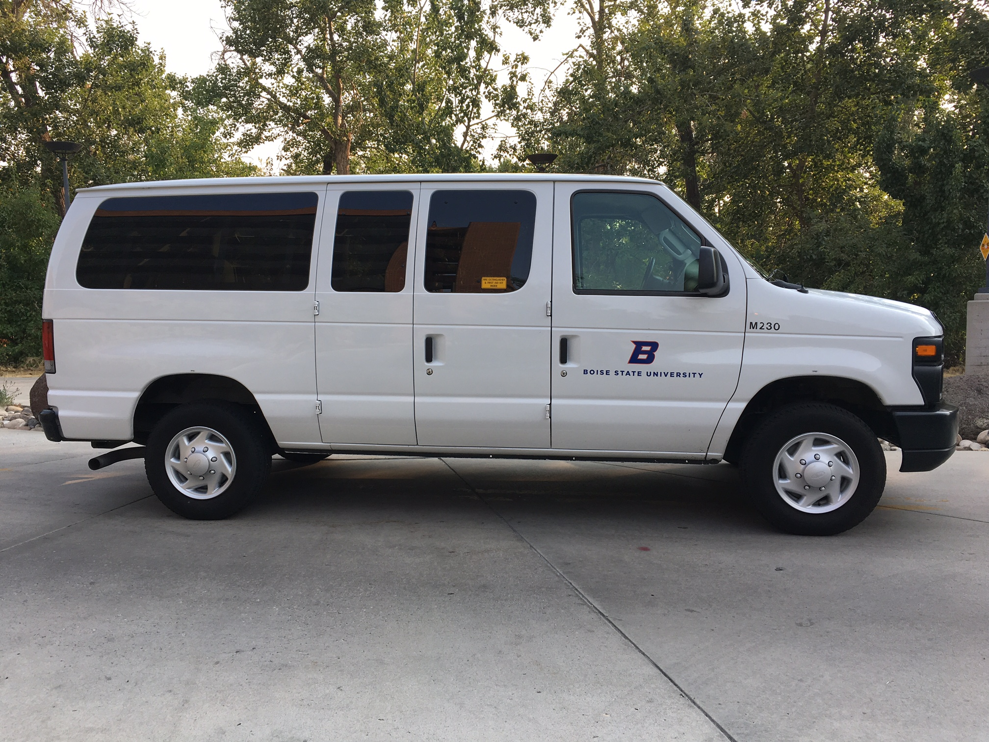 White 12 Person Passenger Van