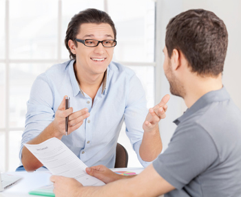 two employees talking to one another