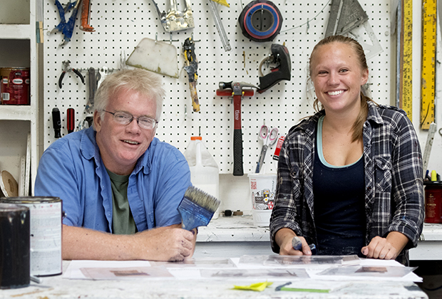 Man and woman in tool workshop